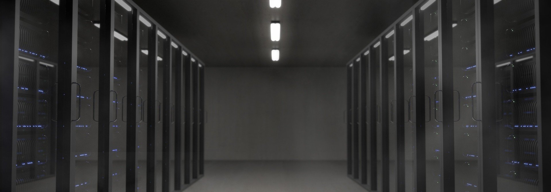 Image of a space with many servers. A server room.